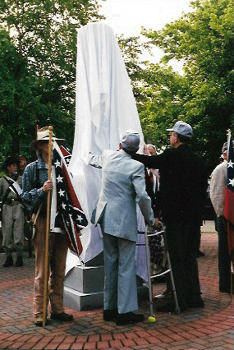 Mill worker descendant, George Kendley assists with the unveiling, July 2000.